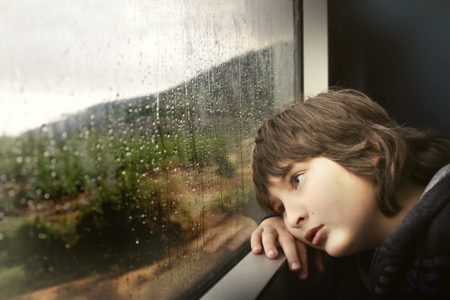 Child looking out of a window