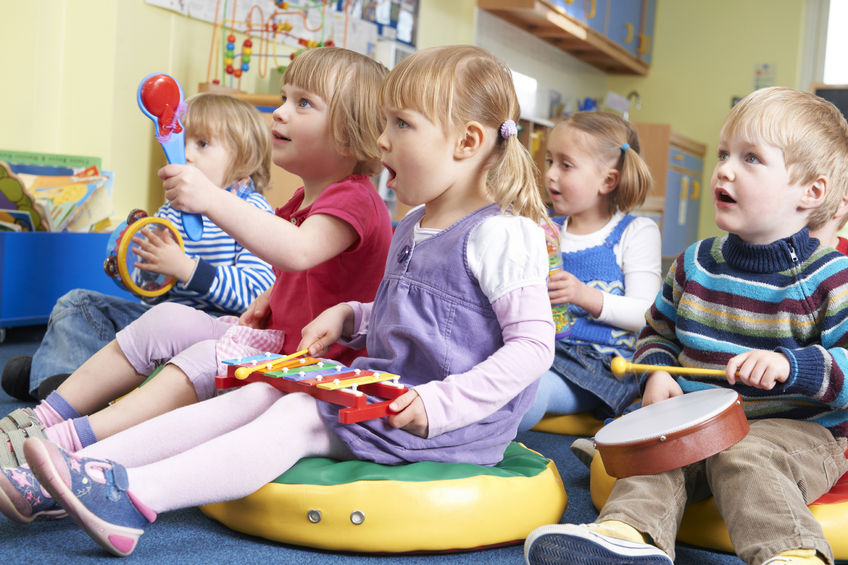 early years music children taking part in music lesson