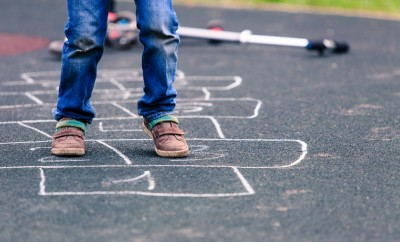 45128146 - kid playing hopscotch on playground outdoors, children outdoor activities