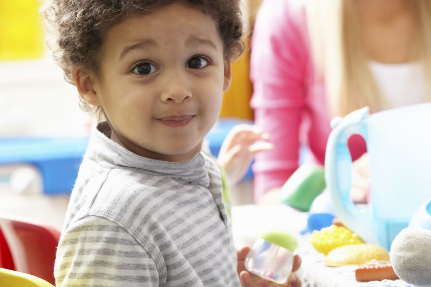 boy playing with toys in autism friendly nursery