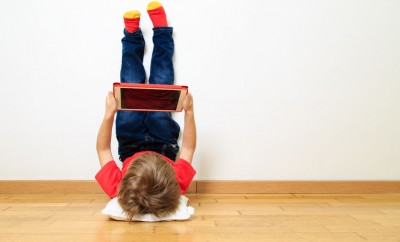 digital natives looking at touchscreen at home