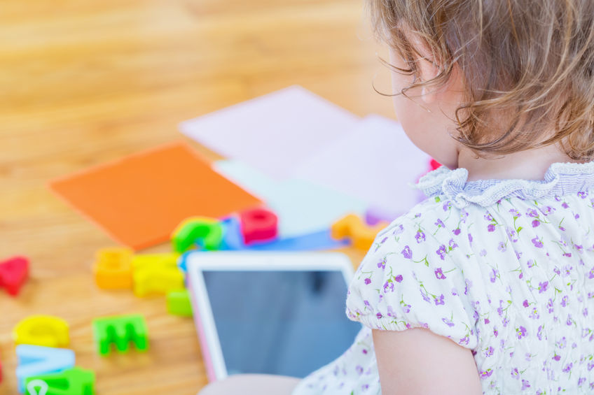 45663146 - toddler girl watching a tablet computer