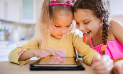 2 girls using digital technologies in the nursery