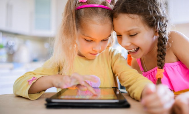 2 girls using digital technologies in the nursery