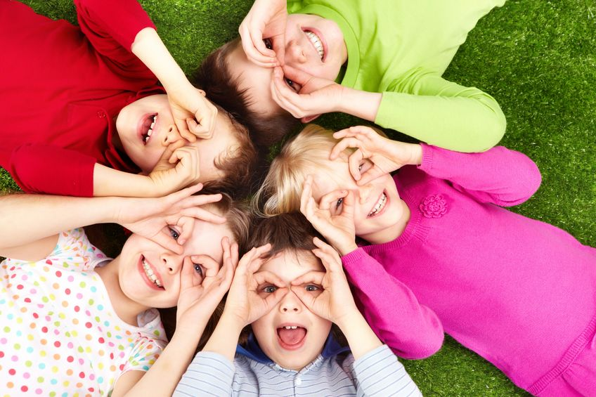 6894310 – image of funny kids playing on the grass
