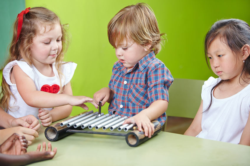27574815 – boy playing xylophone in kindergarten at musical education