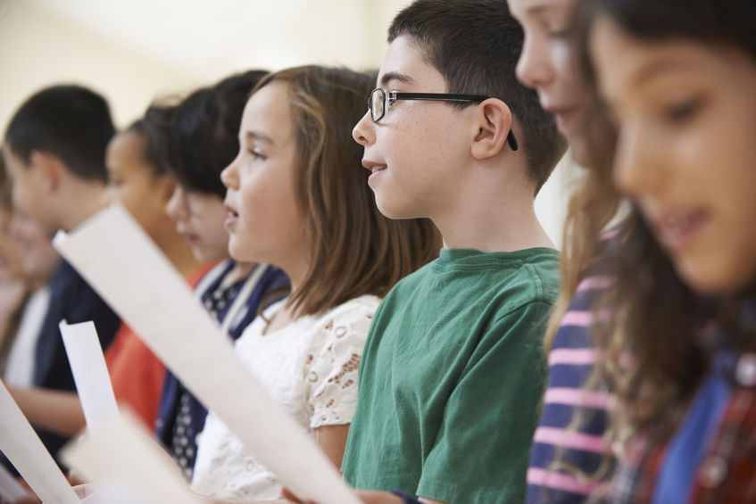 46129047 – group of school children singing in choir together