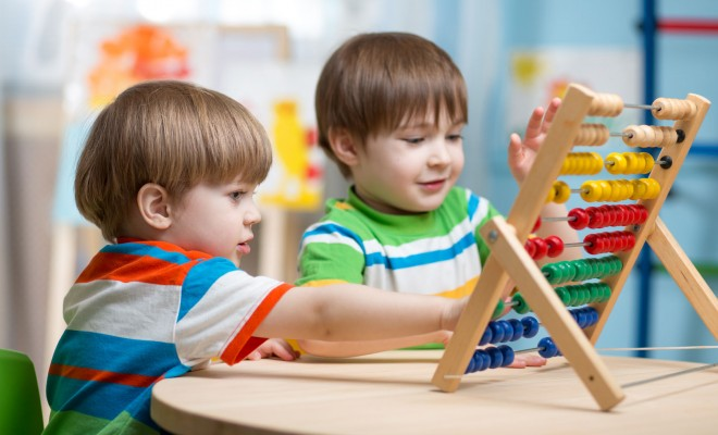 Numeracy Skills - Children counting on an abacus