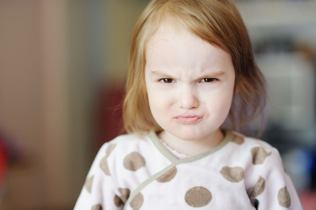 12789457 – portrait of little angry toddler girl