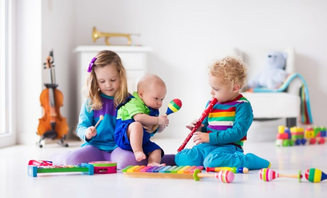 Best musical toys - children playing with instruments