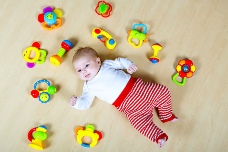 Best musical toys for early years - Baby with rattles
