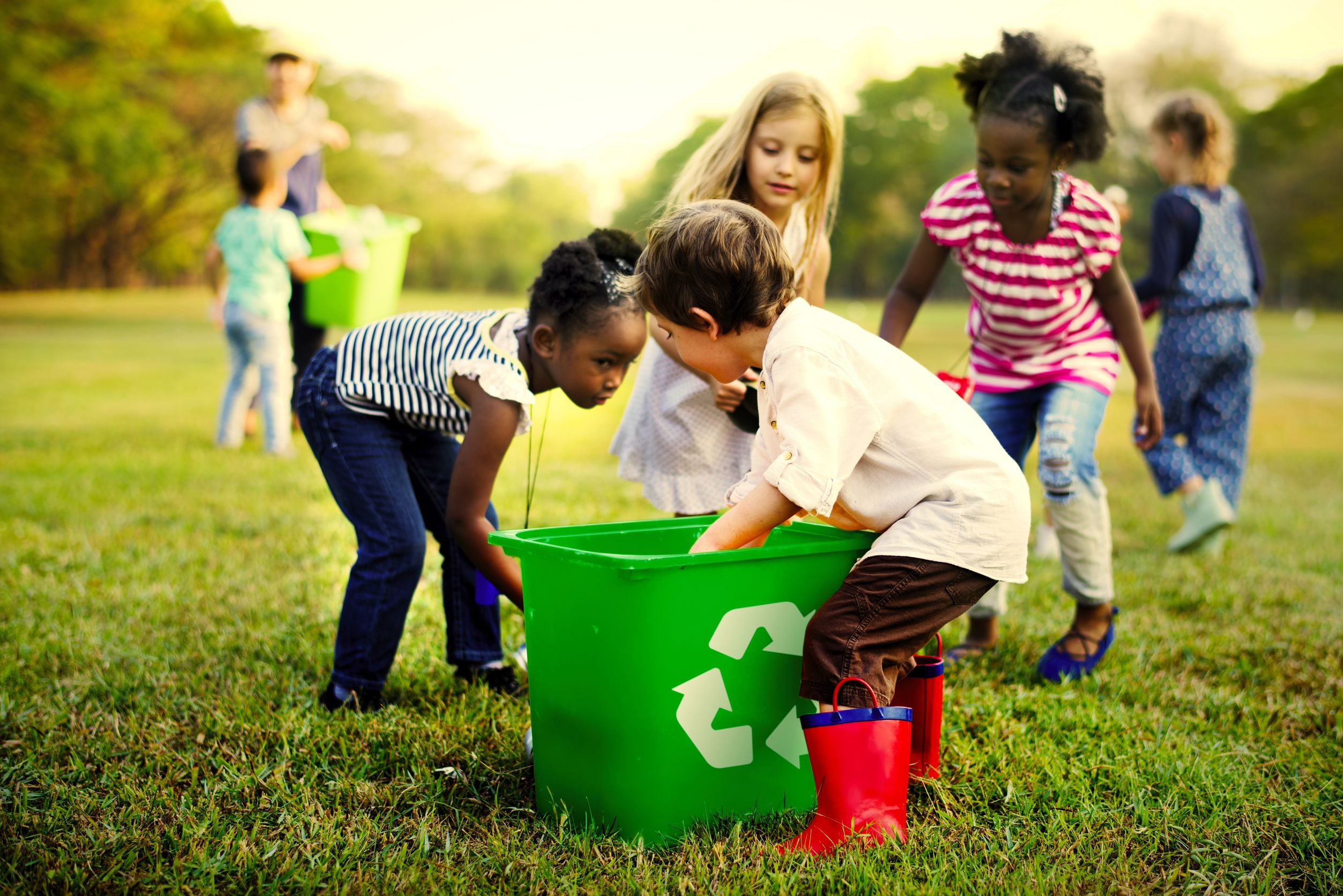 Kids learning how to recycle trash