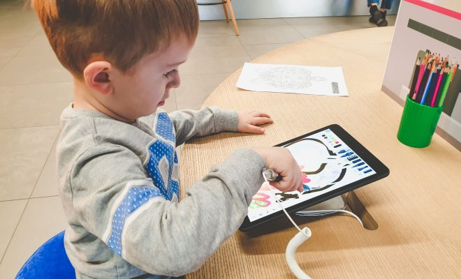 child being creative using technology