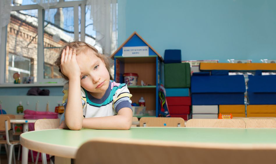21234179 – sad child in kindergarten. depression girl in nursery school